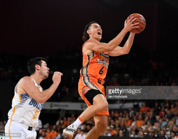 Jarrod Kenny of the Taipans attempts a lay up during the round 7 NBL match between the Cairns Taipans and the Brisbane Bullets on November 16, 2019...