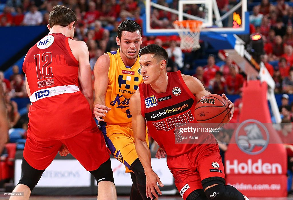 Jarrod Kenny of the Wildcats controls the ball against Jason Cadee of the Kings during the round seven NBL match between the Perth Wildcats and the Sydney Kings at Perth Arena on November 17, 2016 in Perth, Australia.