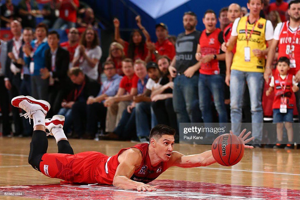 Jarrod Kenny of the Wildcats dives for the ball during the round seven NBL match between the Perth Wildcats and the Sydney Kings at Perth Arena on November 17, 2016 in Perth, Australia.