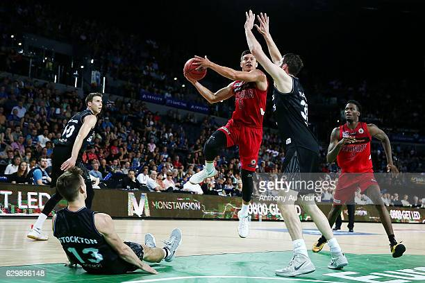 Jarrod Kenny of the Wildcats goes up against Alex Pledger of the Breakers during the round 11 NBL match between New Zealand Breakers and Perth...