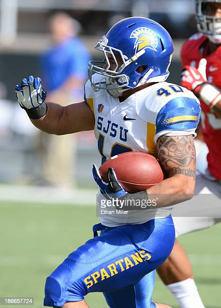 Jarrod Lawson of the San Jose State Spartans runs for yardage against the UNLV Rebels during their game at Sam Boyd Stadium on November 2 2013 in Las...