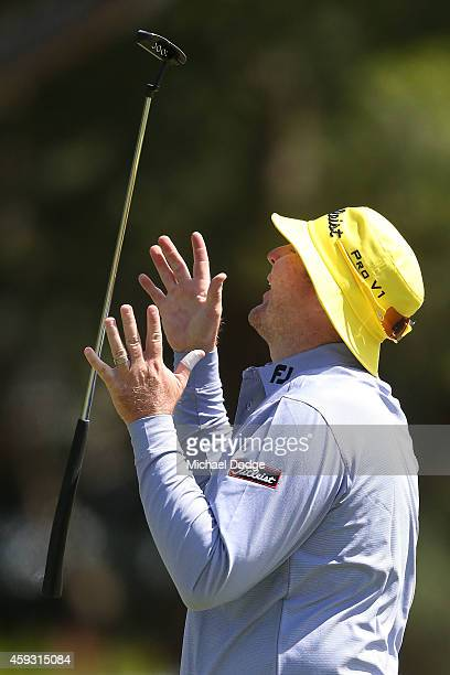 Jarrod Lyle of Austraia reacts after missing a putt on the 3rd hole during day two of the Australian Masters at The Metropolitan Golf Course on...