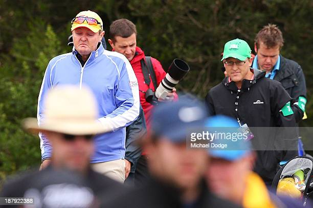 Jarrod Lyle of Australia cries on his way to the first tee during round one of the 2013 Australian Masters at Royal Melbourne Golf Course on November...