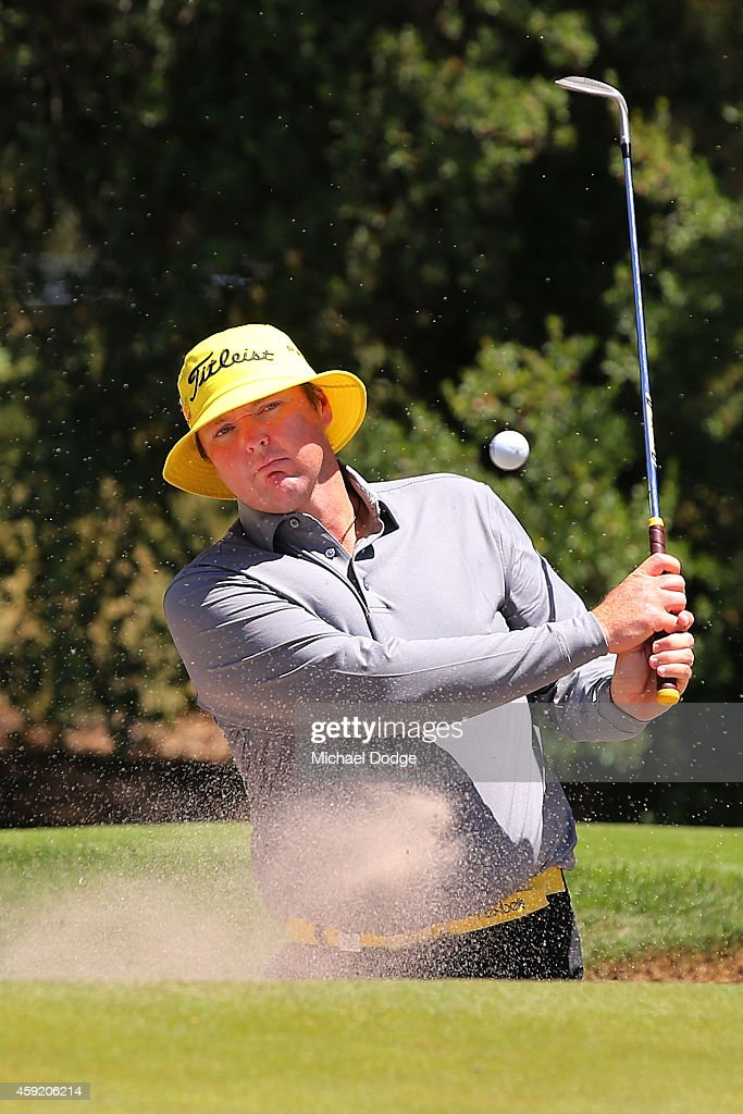 Jarrod Lyle of Australia hits an approach shot form the bunker ahead of the 2014 Australian Masters at The Metropolitan Golf Course on November 19, 2014 in Melbourne, Australia.