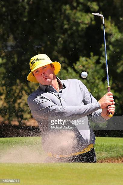 Jarrod Lyle of Australia hits an approach shot form the bunker ahead of the 2014 Australian Masters at The Metropolitan Golf Course on November 19...