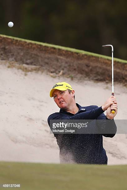 Jarrod Lyle of Australia hits out of a bunker ahead of the 2014 Australian Masters at The Metropolitan Golf Course on November 18 2014 in Melbourne...