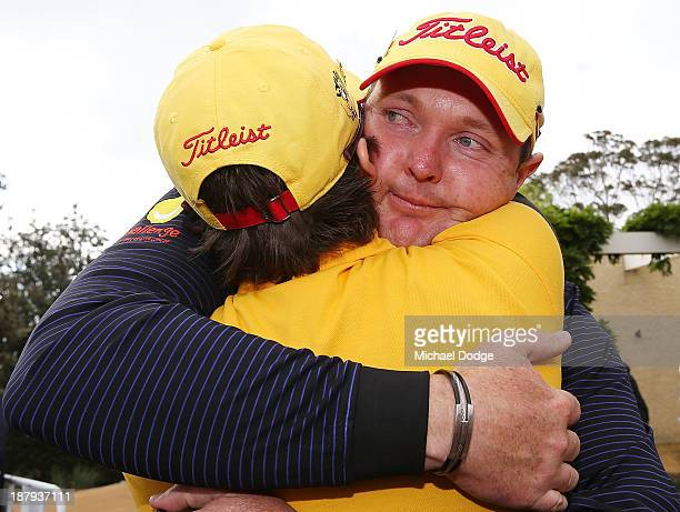 Jarrod Lyle of Australia hugs wife Briony Lyle after the 18th hole during round one of the 2013 Australian Masters at Royal Melbourne Golf Course on...
