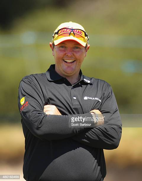Jarrod Lyle of Australia laughs on the 18th green as he completes his round during round four of the 2013 Australian Masters at Royal Melbourne Golf...