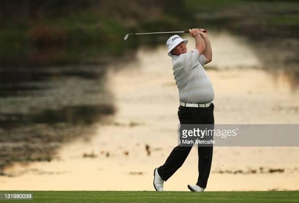 Jarrod Lyle of Australia plays his second shot on the 1st hole during day one of the 2011 Emirates Australian Open at The Lakes Golf Club at The...