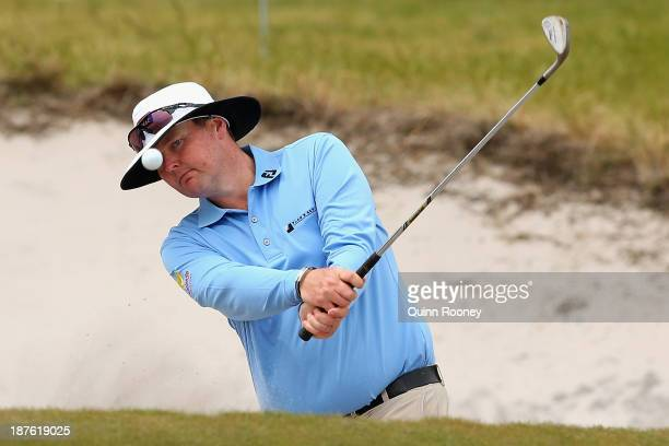 Jarrod Lyle of Australia plays out of the bunker during previews ahead of the 2013 Australian Masters at Royal Melbourne Golf Course on November 11...