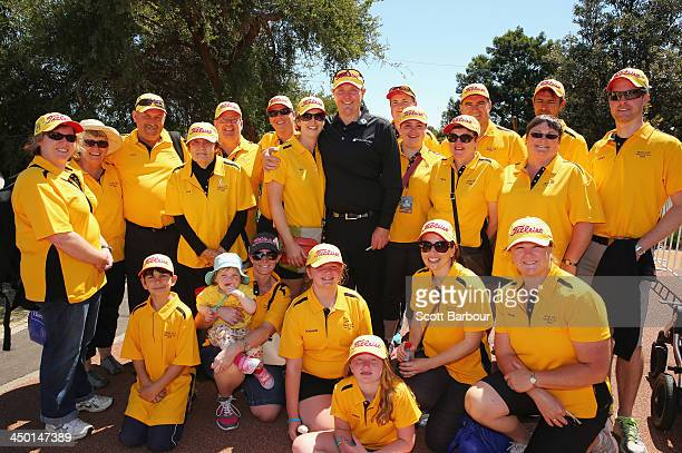 Jarrod Lyle of Australia poses with his wife Briony his daughter Lusi and supporters after completing his round during round four of the 2013...