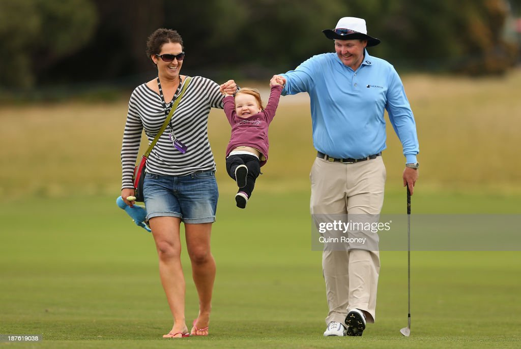 Jarrod Lyle of Australia walks the course with wife Briony and daughter Lusi during previews ahead of the 2013 Australian Masters at Royal Melbourne Golf Course on November 11, 2013 in Melbourne, Australia.
