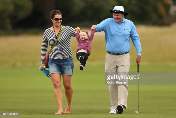 Jarrod Lyle of Australia walks the course with wife Briony and daughter Lusi during previews ahead of the 2013 Australian Masters at Royal Melbourne...