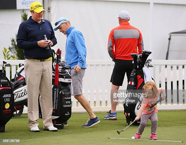 Jarrod Lyle of Australia watches daughter Lucy Lyle putt on the practice green ahead of the 2014 Australian Masters at The Metropolitan Golf Course...