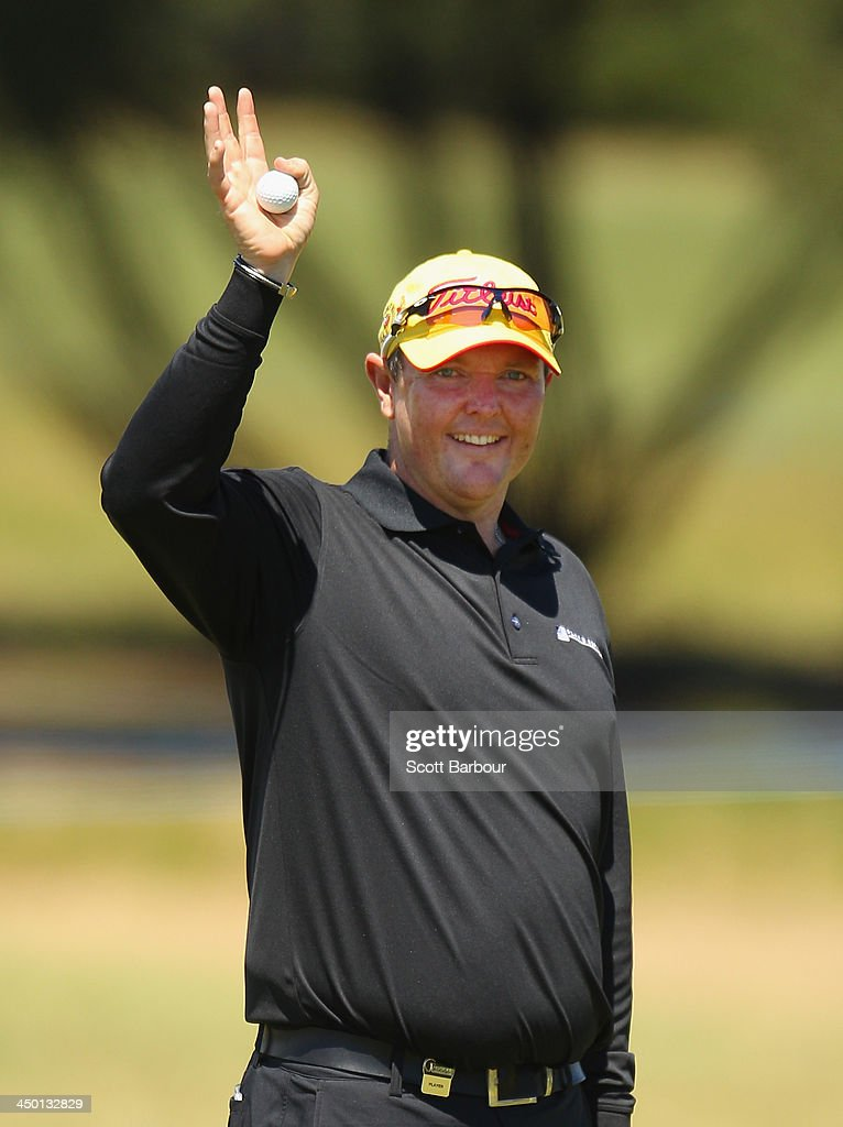 Jarrod Lyle of Australia waves to his family on the 18th green as he completes his round during round four of the 2013 Australian Masters at Royal Melbourne Golf Course on November 17, 2013 in Melbourne, Australia.