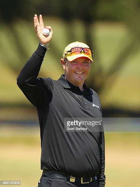 Jarrod Lyle of Australia waves to his family on the 18th green as he completes his round during round four of the 2013 Australian Masters at Royal...