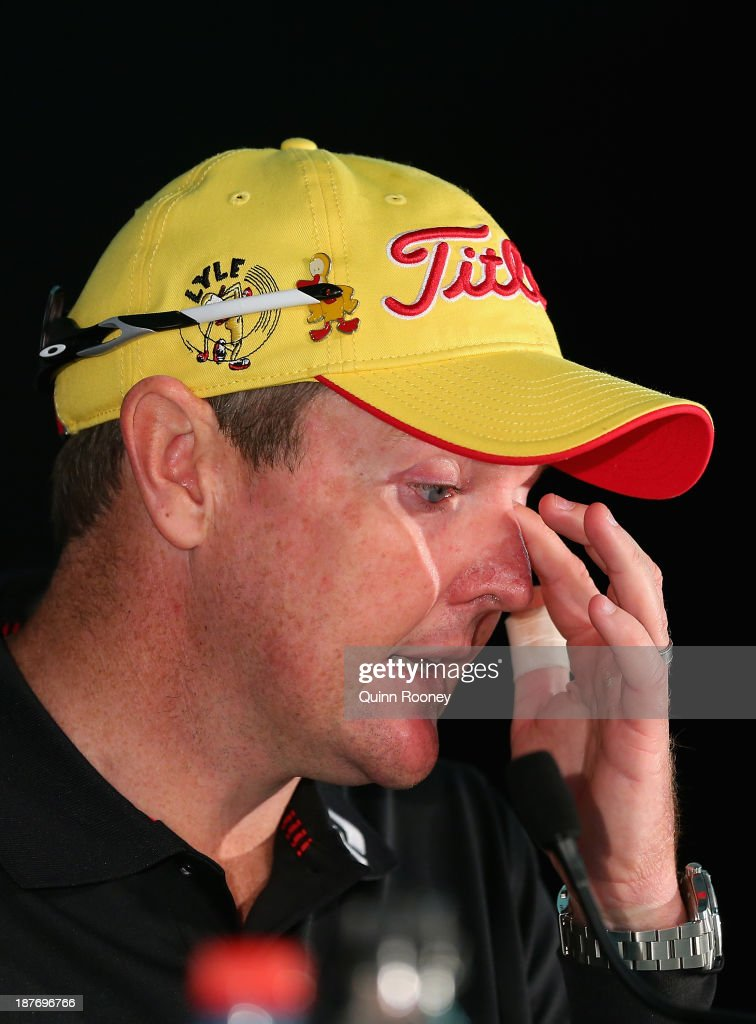 Jarrod Lyle of Australiawipes a tear from his eye as he speaks to the media during previews ahead of the 2013 Australian Masters at Royal Melbourne Golf Course on November 12, 2013 in Melbourne, Australia.