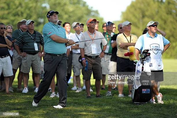Jarrod Lyle watches his second shot on the fourth hole during the second round of the AT&T National at Aronimink Golf Club on July 2, 2010 in Newtown...