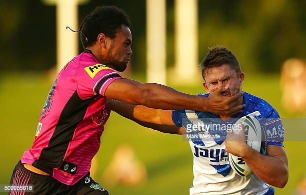 Jarrod McInally of the Bulldogs is tackled by Zach DockarClay of the Panthers during the NRL Trial match between the Canterbury Bulldogs and the...