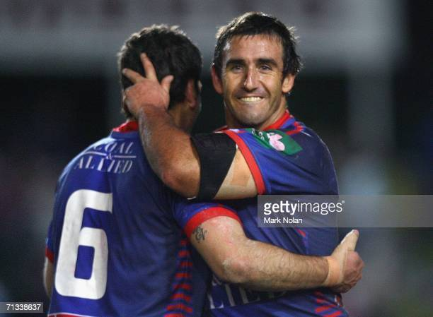 Jarrod Mullen and Andrew Johns of the Knights celebrate their win after the round 17 NRL match between the Manly Warringah Sea Eagles and the...