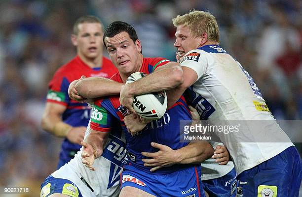 Jarrod Mullen of the Knights is tackled during the third NRL qualifying final match between the Bulldogs and the Newcastle Knights at ANZ Stadium on...