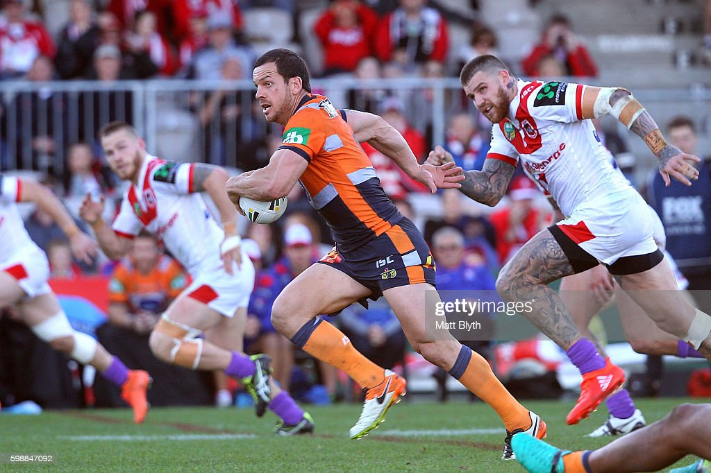 Jarrod Mullen of the Knights makes a break during the round 26 NRL match between the St George Illawarra Dragons and the Newcastle Knights at WIN Jubilee Stadium on September 3, 2016 in Sydney, Australia.