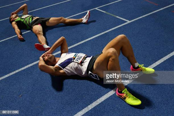Jarrod Pageot and Chris White of Victoria collapse after the mens open decathlon 1500m during day six of the Australian Athletics Championships at...