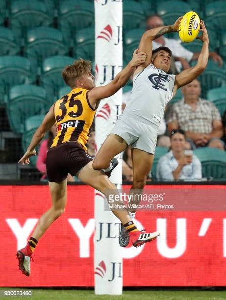 Jarrod Pickett of the Blues marks the ball over Harry Morrison of the Hawks during the AFL 2018 JLT Community Series match between the Hawthorn Haws...