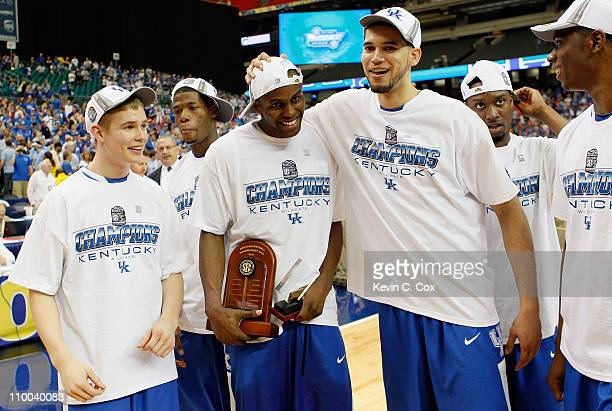 Jarrod Polson, MVP Darius Miller and Elroy Vargas of the Kentucky Wildcats celebrate their 70 to 54 win over the Florida Gators in the championship...