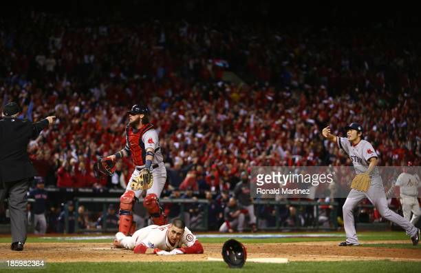 Jarrod Saltalamacchia and Koji Uehara of the Boston Red Sox react as Home Plate Umpire Dana DeMuth calls Allen Craig of the St Louis Cardinals safe...