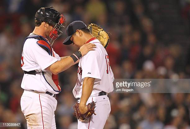 Jarrod Saltalamacchia consoles Daisuke Matsuzaka of the Boston Red Sox after a sixrun second inning against the Tampa Bay Rays at Fenway Park April...