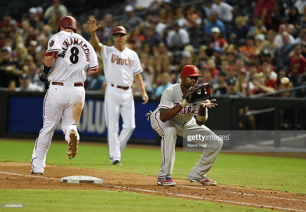 Jarrod Saltalamacchia #8 of the Arizona Diamondbacks beats out the throw after a dropped third strike as Ryan Howard #6 of the Philadelphia Phillies waits for the ball during the fourth inning at Chase Field on August 11, 2015 in Phoenix, Arizona.