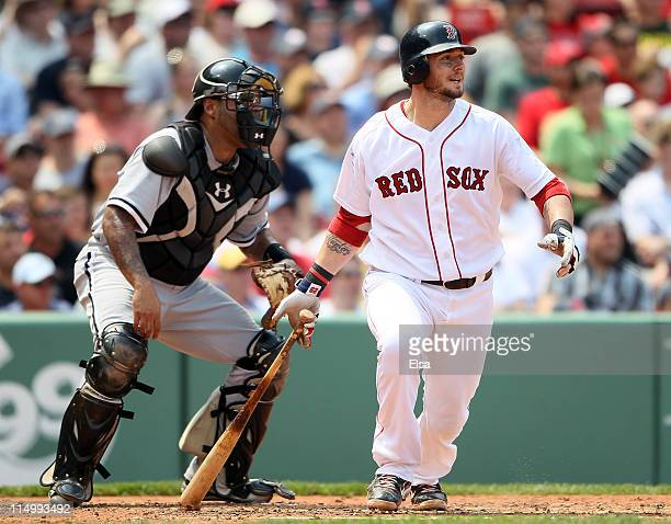 Jarrod Saltalamacchia of the Boston Red Sox gets 2 RBI on a hit in the second inning as Ramon Castro of the Chicago White Sox catches on June 1 2011...