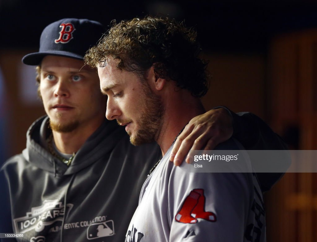 Jarrod Saltalamacchia #39 of the Boston Red Sox is consoled by teammate Clay Buchholz #11 after the loss to the New York Yankees on October 3, 2012 at Yankee Stadium in the Bronx borough of New York City. With the win, the New York Yankees clinch the A.L. East Division title.