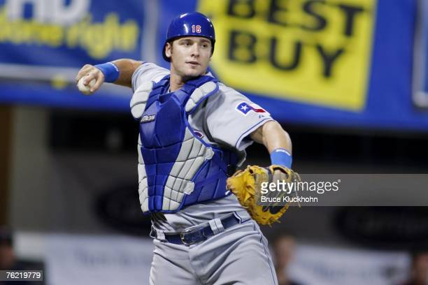 Jarrod Saltalamacchia of the Texas Rangers throws the ball in a game against the Minnesota Twins at the Humphrey Metrodome in Minneapolis Minnesota...