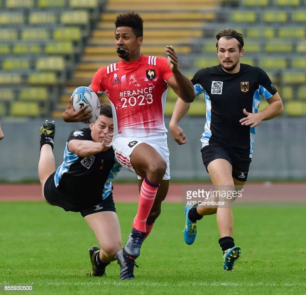 Jarrod Saul of Germany tackles Josias Daoudou of France during the match Germany vs France at the Rugby Oktoberfest7s in Munich southern Germany on...