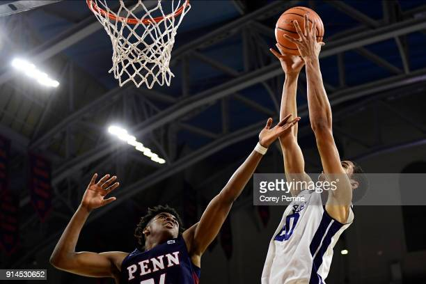 Jarrod Simmons of the Pennsylvania Quakers is out rebounded by Paul Atkinson of the Yale Bulldogs during the first half at The Palestra on February 3...