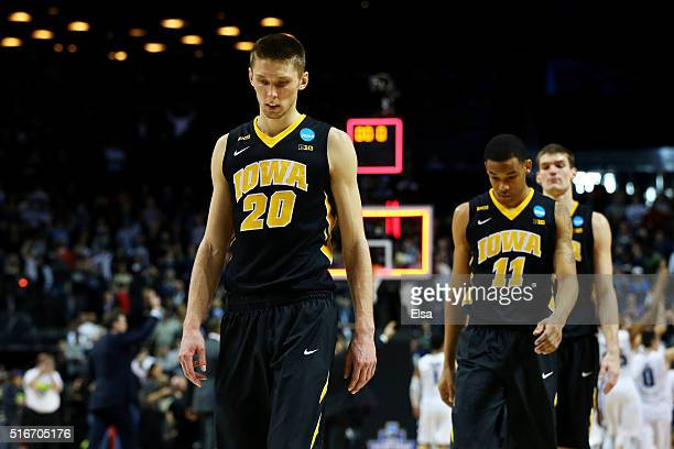 Jarrod Uthoff and teammates of the Iowa Hawkeyes walk off of the court after their 68 to 87 loss to the Villanova Wildcats during the second round of...