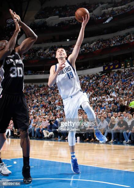 Jarrod Uthoff of the Dallas Mavericks goes for a lay up against the San Antonio Spurs during the game on April 7 2017 at the American Airlines Center...