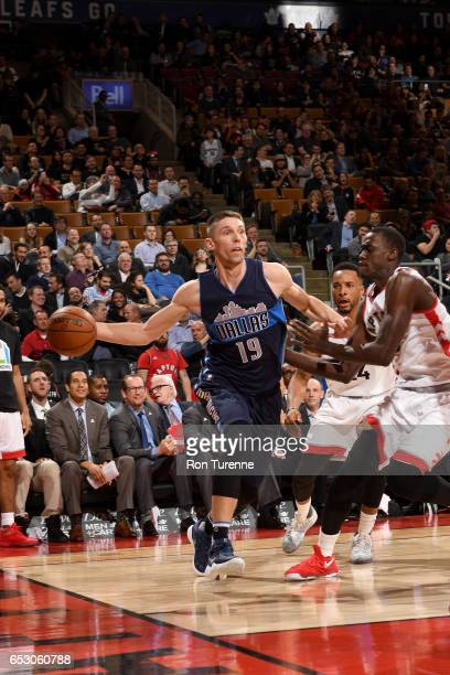 Jarrod Uthoff of the Dallas Mavericks passes the ball against the Toronto Raptors on March 13 2017 at the Air Canada Centre in Toronto Ontario Canada...