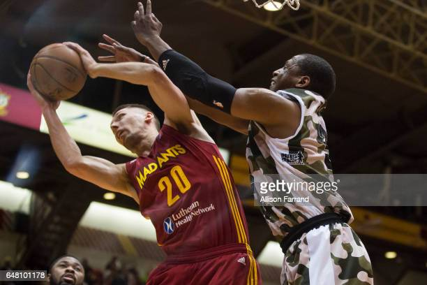 Jarrod Uthoff of the Fort Wayne Mad Ants and Jonathan Holmes of the Canton Charge fight for a rebound at the Canton Memorial Civic Center on March 4...