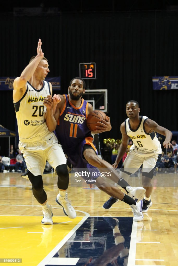 Jarrod Uthoff #20 of the Fort Wayne Mad Ants battles Rahlir Hollis-Jefferson #11 of the Northern Arizona Sunns during their NBDL game at Memorial Coliseum on November 26, 2017 in Fort Wayne, Indiana.