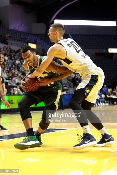 Jarrod Uthoff of the Fort Wayne Mad Ants grabs the ball against Joel Bolomboy of the Wisconsin Herd on February 1 2018 at Memorial Coliseum in Fort...