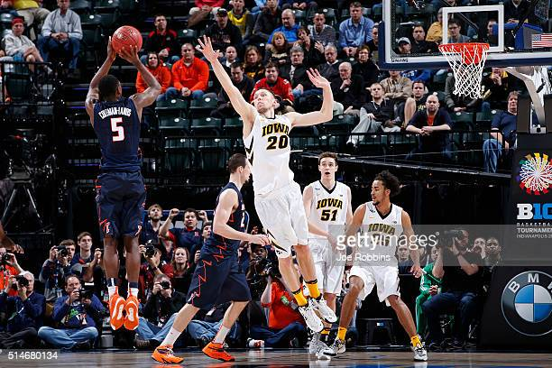 Jarrod Uthoff of the Iowa Hawkeyes defends against Jalen ColemanLands of the Illinois Fighting Illini in the second round of the Big Ten Basketball...