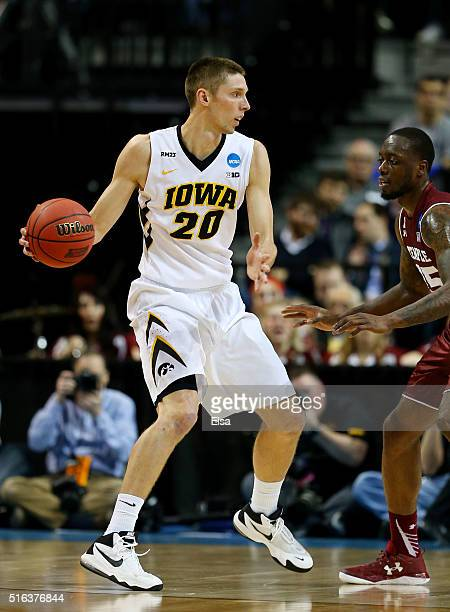 Jarrod Uthoff of the Iowa Hawkeyes drives against Jaylen Bond of the Temple Owls in the first half during the first round of the 2016 NCAA Men's...