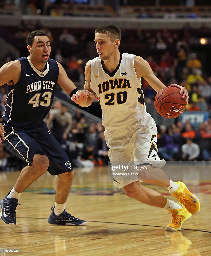 Jarrod Uthoff #20 of the Iowa Hawkeyes drives against Ross Travis #43 of the Penn State Nittany Lions during the second round of the 2015 Big Ten Men's Basketball Tournament at the United Center on March 12, 2015 in Chicago, Illinois.