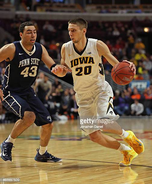 Jarrod Uthoff of the Iowa Hawkeyes drives against Ross Travis of the Penn State Nittany Lions during the second round of the 2015 Big Ten Men's...