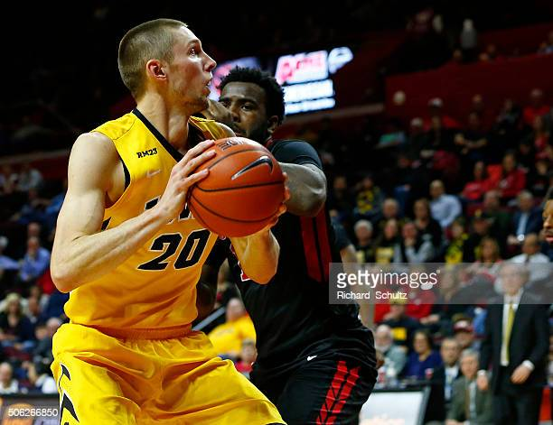 Jarrod Uthoff of the Iowa Hawkeyes looks to shoot as DJ Foreman the Rutgers Scarlet Knights defends during the second half of a college basketball...