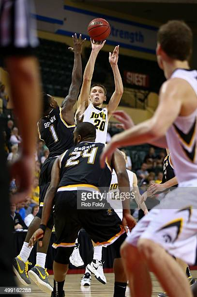 Jarrod Uthoff of the Iowa Hawkeyes shoots over Zach Brown of the Wichita State Shockers during the game at HP Field House on November 29 2015 in...