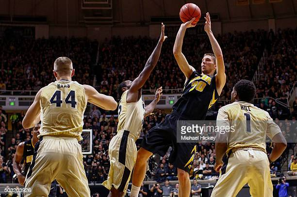 Jarrod Uthoff of the Iowa Hawkeyes shoots the ball against Rapheal Davis of the Purdue Boilermakers at Mackey Arena on January 2 2016 in West...